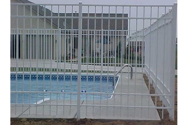 See through fence protecting pool.